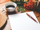 blank-paper-with-pen-and-coffee-cup-on-wood-table